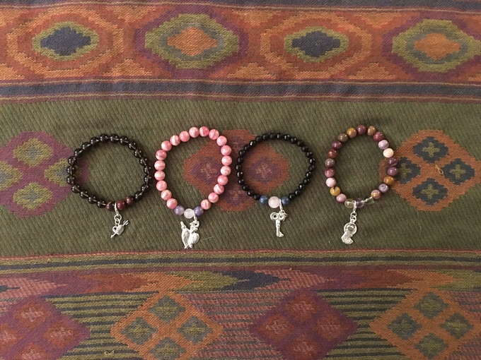 Touchstone bracelets are customized with additional gemstones and a divination charm chosen during the reading