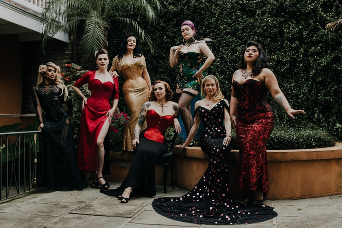 © Martindale Media. Ariana Amour, Hellin Heels, Autumn Adamme, Annabelle Zakaluk, Victoria Dagger, Kathleen Parke, and Grandma Fun model Dark Garden Couture in the courtyard of Kathleen's French Quarter abode.