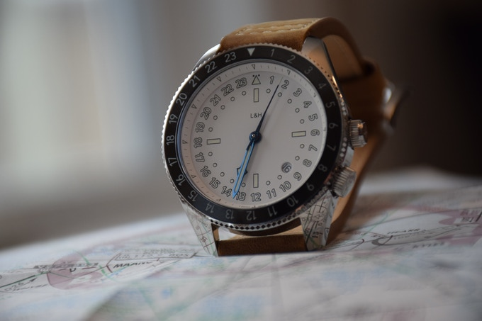 White version features thermally blued hour, minute and second hands.