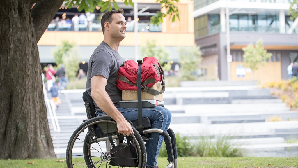 LapStacker™ - Retractable Strap System for Wheelchairs