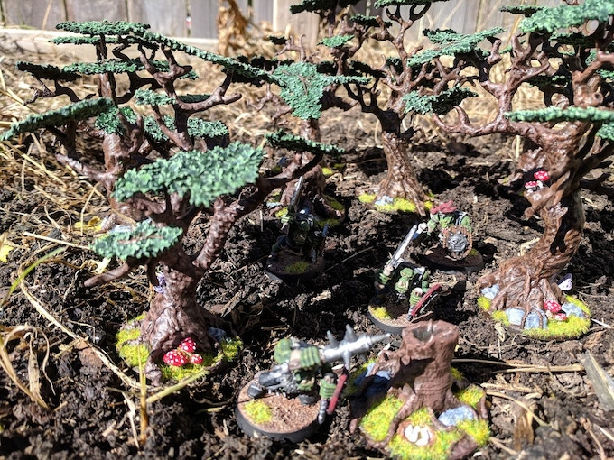 Orcs prowl through the dense forest