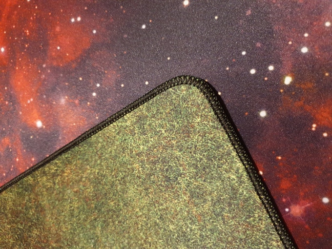 Zoomed in detail of the stitched edge on the prototype Red Star / Grass mat