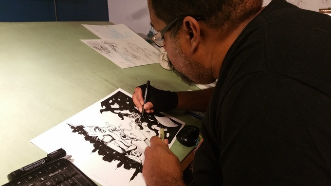 Don Walker working on his exclusive art for The Crossroads