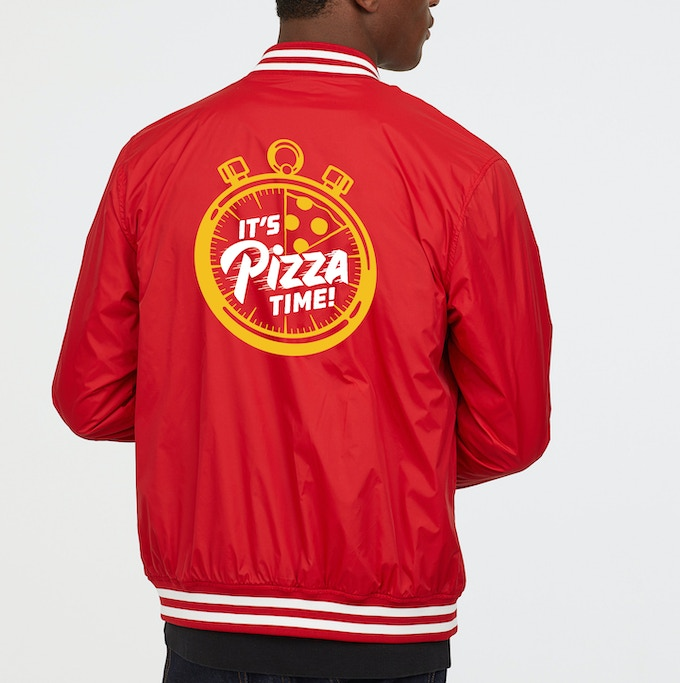 """A rough mockup of the """"It's Pizza Time"""" employee jacket. Logo will be embroidered."""