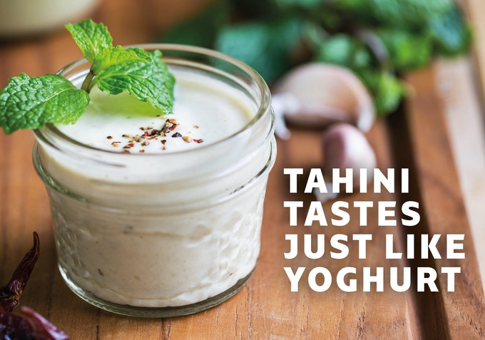 Tahini /tɑːˈhiːni/ (also tahina /-nə/; Arabic: طحينة‎, Greek: ταχίνι; also tehina Hebrew: טחינה, or ardeh Persian: ارده) is a condiment made from toasted, ground, hulled sesame. It is served by itself (as a dip) or as a major ingredient in hummus, baba ghanoush, and halva. (Wikipedia)