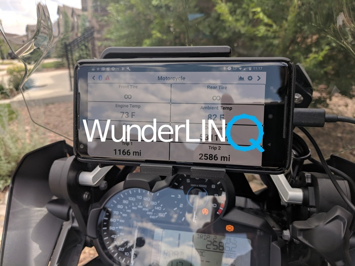Motorcycle smartphone charger/mount that allows hands-free control of user-selected navigation, multi-media player, and communication.