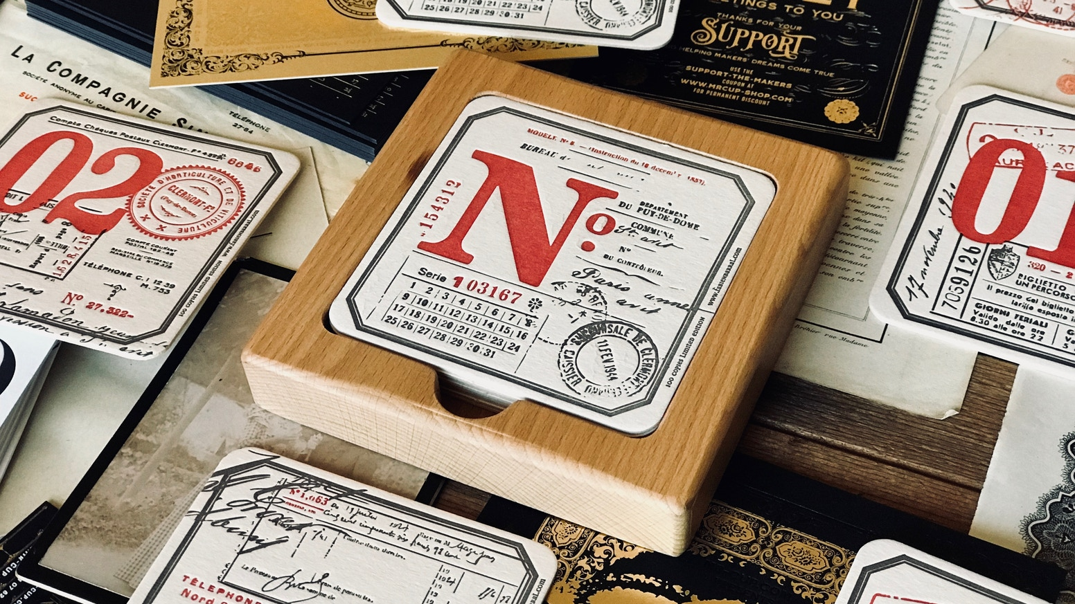 A brand new and improved version of letterpress coasters set with wood box. Limited to 100.