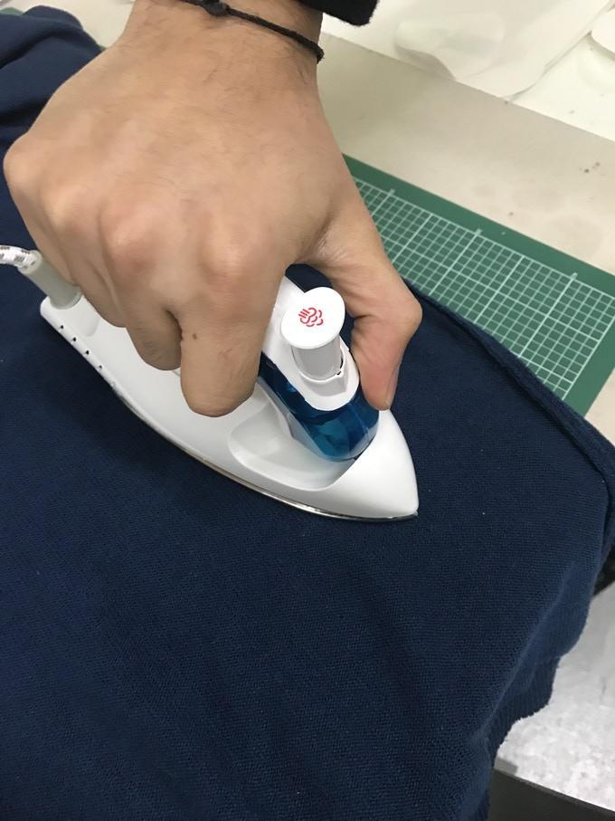 Hold the iron on top of the patch for 30 seconds till it bonds. Let it cool and you're done.