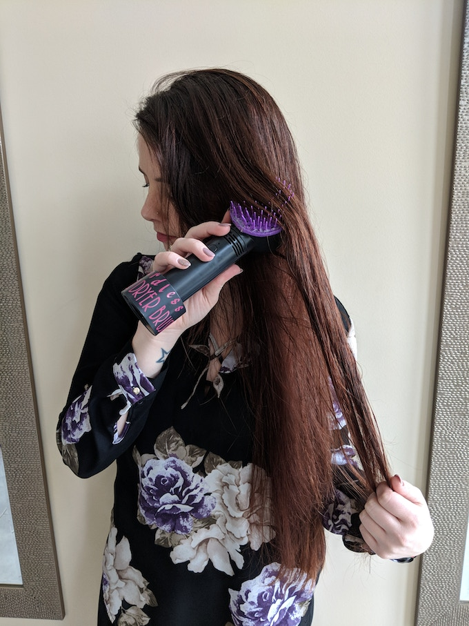 Use the Cordless Hair Dryer Brush at home or on the go