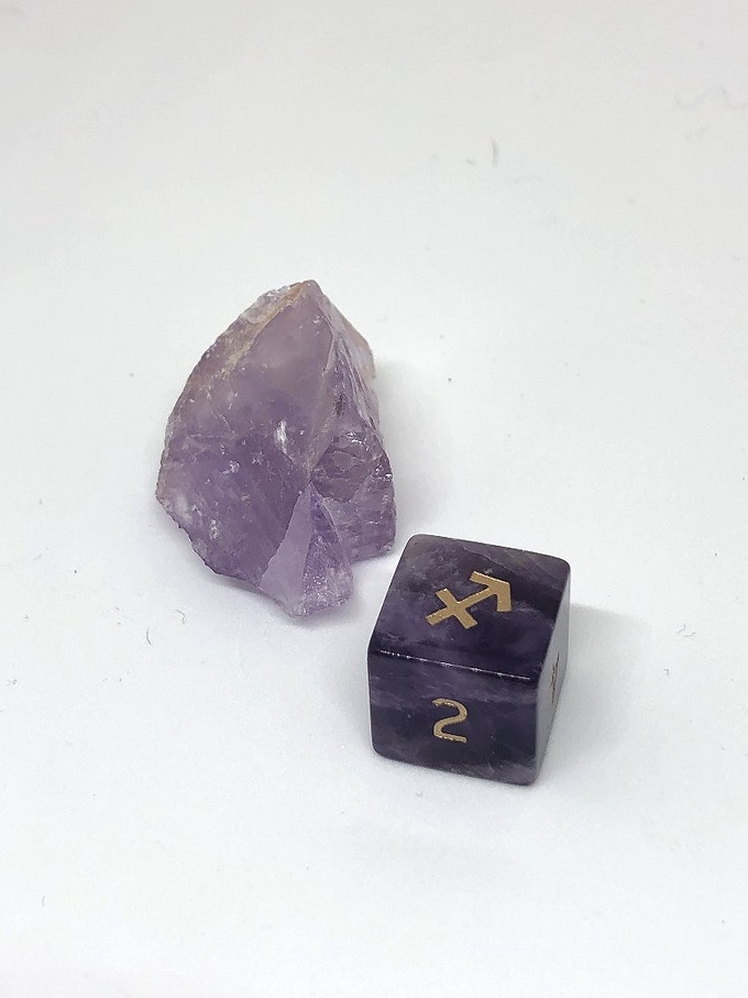 Sagittarius, an example of the finished dice, once carved, engraved, and polished out of Amethyst.