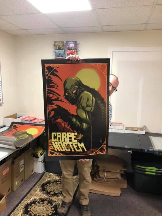 Ryan Wing holds up this monster sized poster in our Split Decision Comics headquarters.