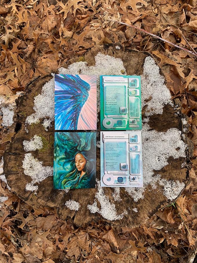 Cards with art by Robert Venosa and Martina Hoffmann