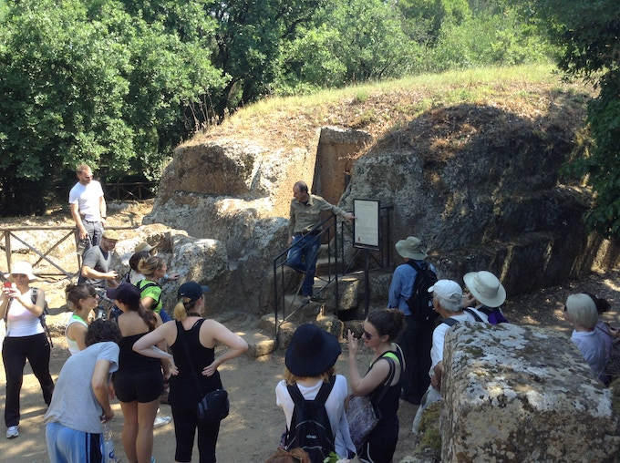 ARCA students on a field trip to Cerveteri, exploring tombs looted by tomb raiders