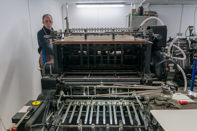 Phil Abel at work at his London printing shop.