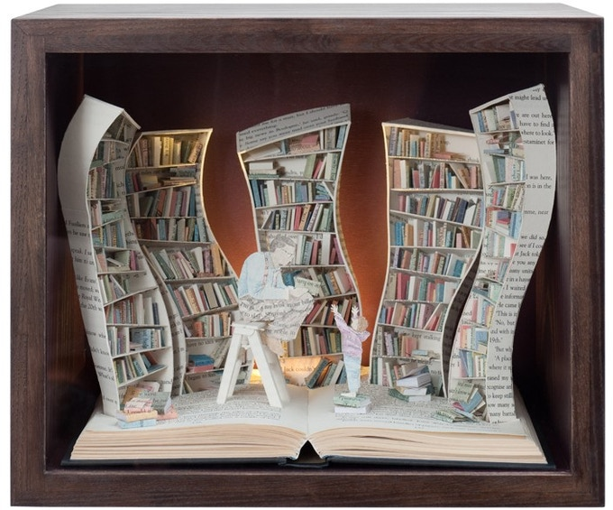 An original book sculpture in display case, with lights. Size approx: 35 x 30 x 25 cm