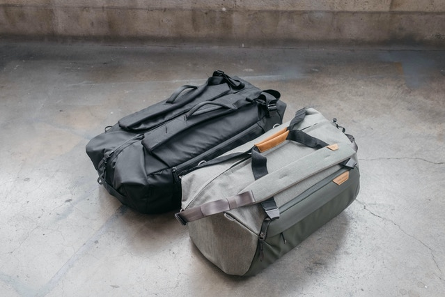 Behold, the latest Duffelpack (black, upper left) and Duffel (sage, lower right) prototypes. Note these two bags are NOT the same size, it just the perspective of this image. The Duffelpack is a max-65L check-in bag, the Duffel is a 35L carry-on. These things are damn near production-ready, and we couldn't be more stoked to show them to you.