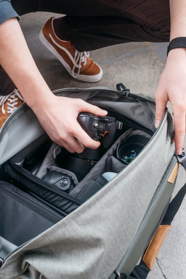 The Duffel has the ability to hold 3 units of Packing Tools. In this shot, it's packed with 1 Small Camera Cube and 1 Medium Camera Cube. The extra-long zip path gives you ample access to the interior volume. Great for packing, unpacking, or shooting.