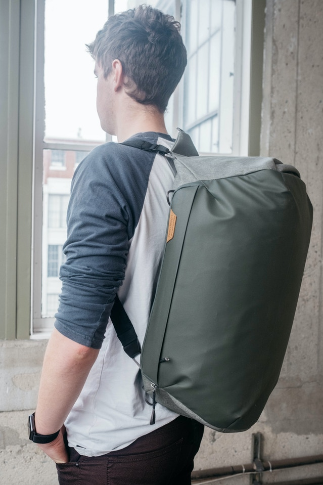 The Duffel will have a network of strong cord loops attached to various points on the bag. These loops will let you attach hand/shoulder straps (via custom hook-style quick connection hardware). We hope to use these cord loops, along with the dual hand straps, to accommodate backpack-style carry, as seen here.