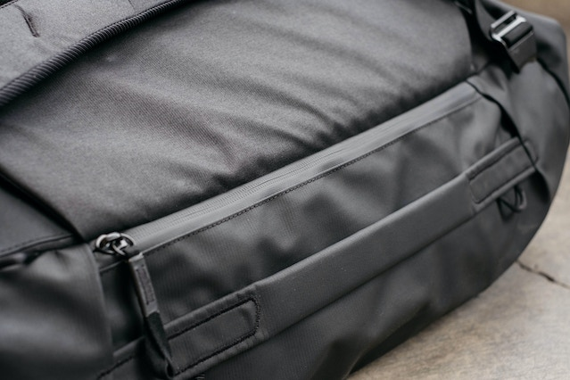 When closed, the Duffelpack's side pockets are discreet and weatherproof.