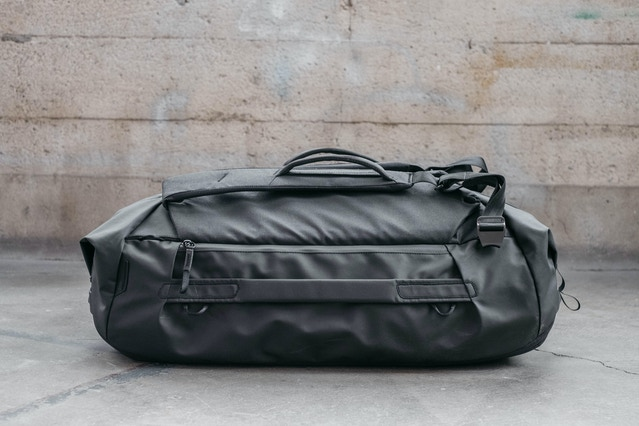 For both the Duffel and Duffelpack (pictured) we upped the denier of the main fabric from 400D to 600D nylon canvas. The heavier material on the bottom is 900D polyester, same as the bottom liner on our other bags. Like our other Travel and Everyday bags, this shell is DWR impregnated, double poly coated, and functionally weatherproof. It's also made from 100% recycled material.