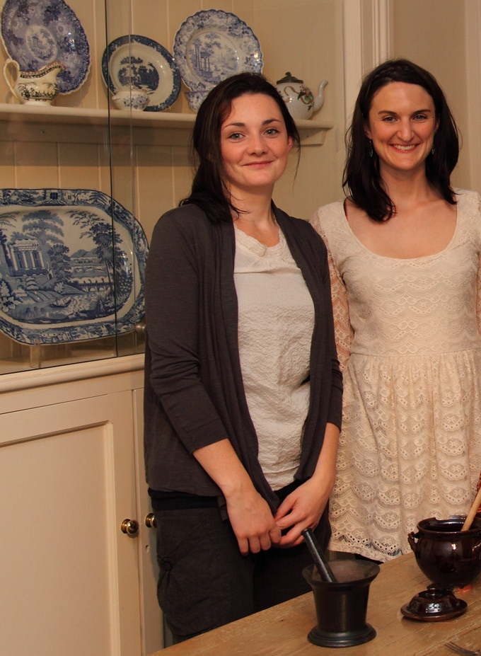 Su with Emma (left), setting up an exhibition at The Bronte Parsonage Museum in Haworth in 2011