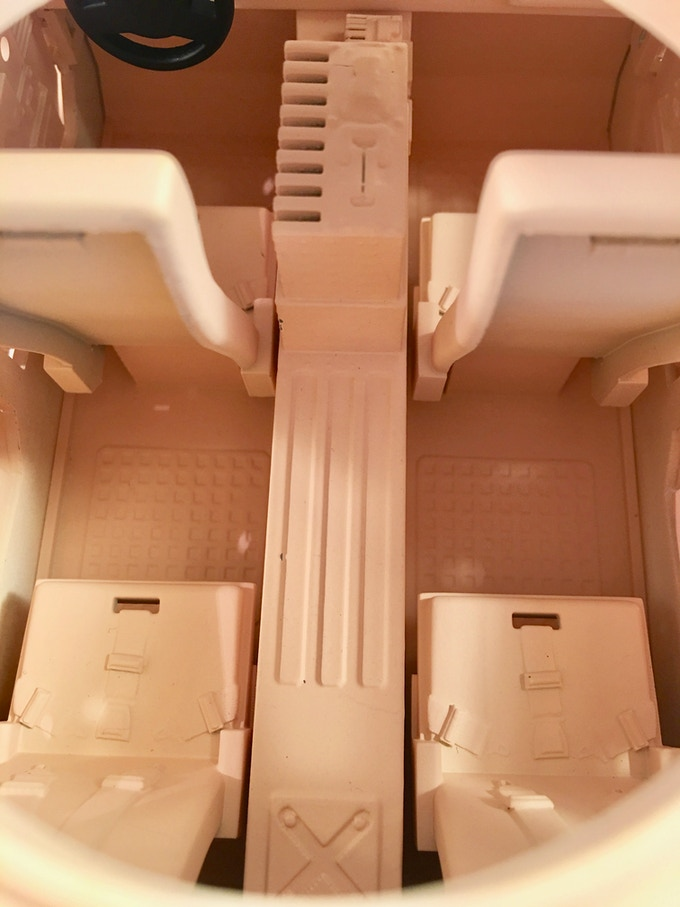 Interior mold details, including sculpted electronics and seatbelts.