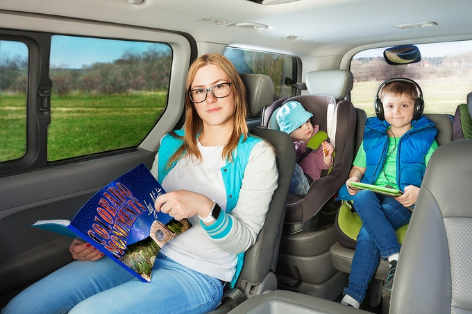 A wonderful, fun-loving family, just like yours, enjoying their book on the road! (Hypothetical view. This may not be your actual family.) Number One Son is following along on the accompanying Google Map, listening to a Norwegian Death Metal group you would certainly not approve of.