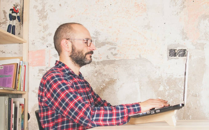 Using a laptop stand will help you to work with a good posture