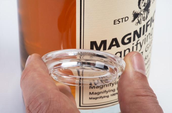 The Glass Lid magnifies 3.3 times (discretely laser engraved on the edge).