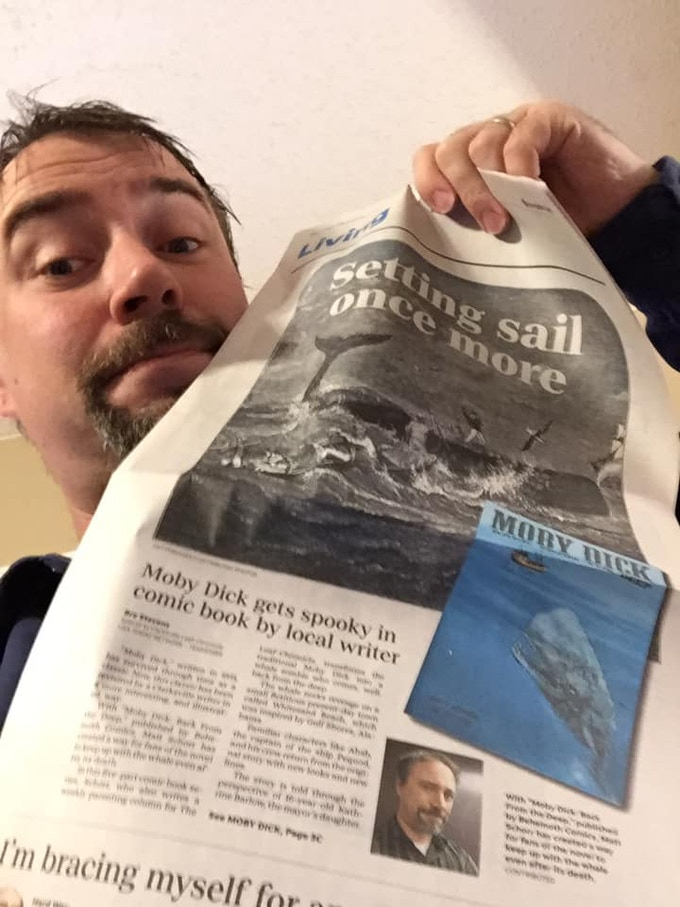 Matt showing a newspaper article covering Back from the Deep #1!