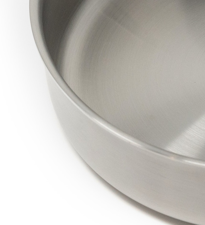 Flared rim for clean, easy, non-drip pouring