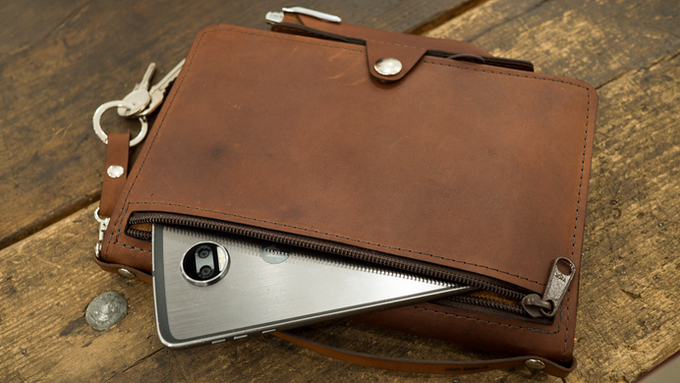 The full-size pocket on the front of the mini-portfolio is a perfect place to tuck your phone, minimalist wallet, and other valuables.