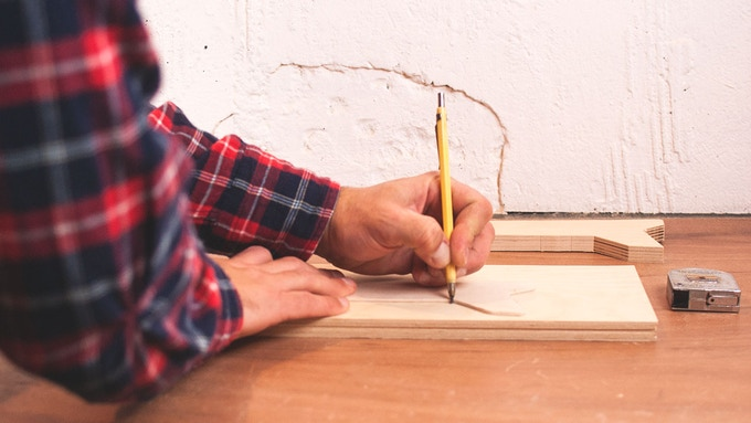 Using a wooden template to draw ISOSCELES shape in the birch board