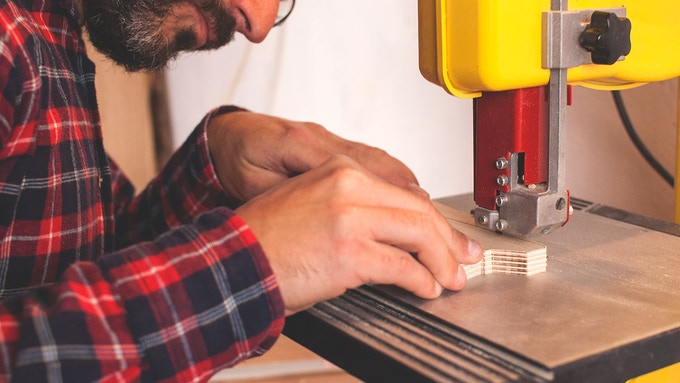 Cutting pieces one by one using a band saw