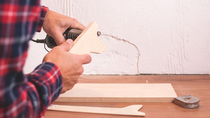 With the dremel hand tool I use to round the corners
