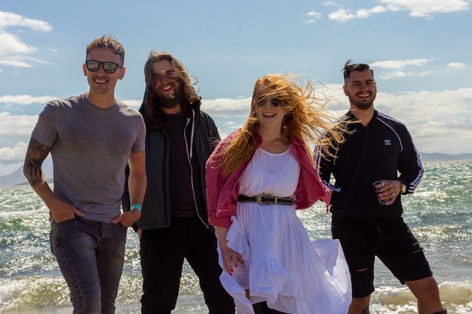 Gav, Liam, Erin & Gia...at the windiest festival of the year in 2018. Seriously, the stage blew away!