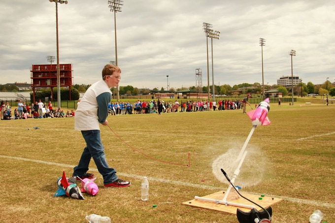 A middle-school student competes in the Tuscaloosa Rocketry Challenge final championship at The University of Alabama campus.