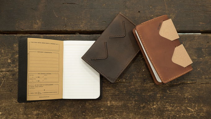 The sleek pocket journal is lined with 12 oz. bull denim, has two card pockets, and is refillable with standard-sized pocket notebooks such as Field Notes.