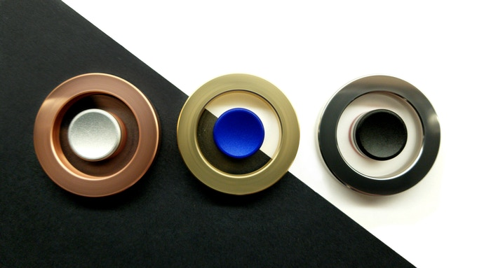 Moment Spinner in Copper, Brass and Stainless steel.