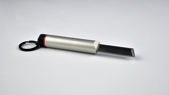 Example of customization: Black back, red ring, aluminum body and stainless steel blade