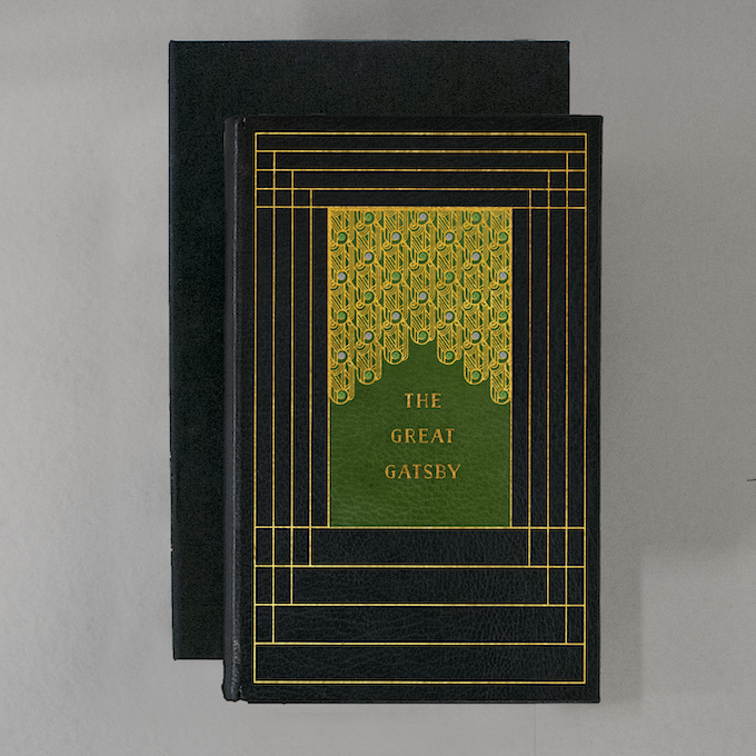 JAY GATSBY will be bound in black Morocco, with green leather laid into the front, and purple leather laid into the back.  The cover is hand tooled with 22 karat gold in a deco design, and set with fourteen opals and eighteen emeralds. Presented in a clamshell box.