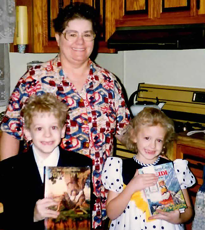 Marissa is holding the Heidi book with her older brother and Grandma. While it is not a romance, there is a happy ending!