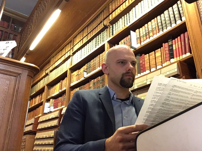 The project creator immersed in occult literature in the Arsenal Library in Paris.