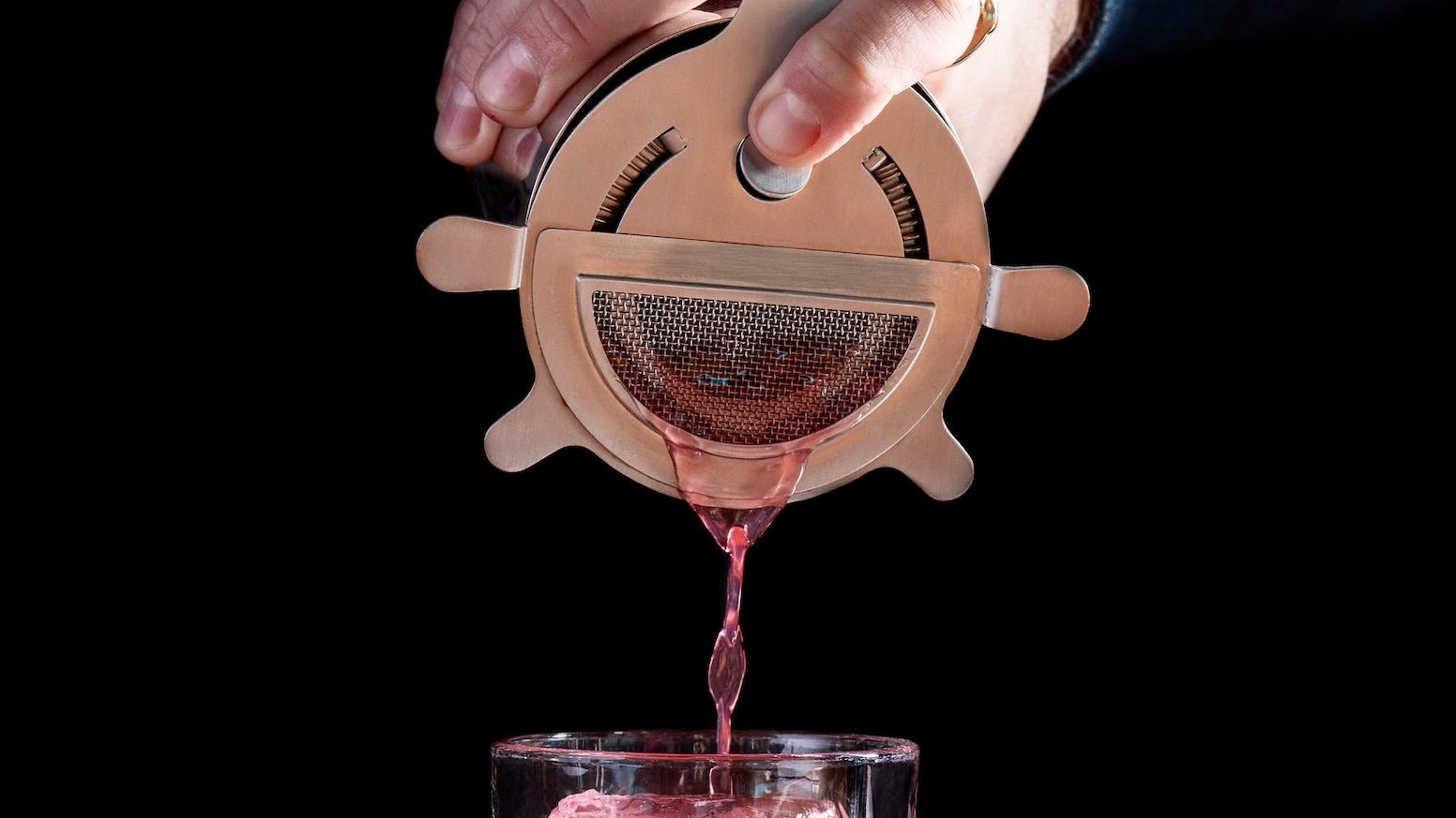 A fine straining cocktail strainer