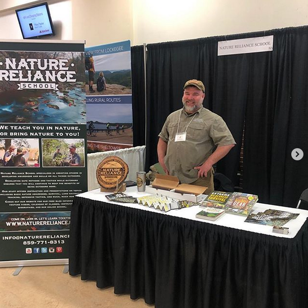 JUST in! Craig is the Keynote Speaker at a Big Event in Kentucky this Weekend - Notice the Tiny Survival Guide on his table...