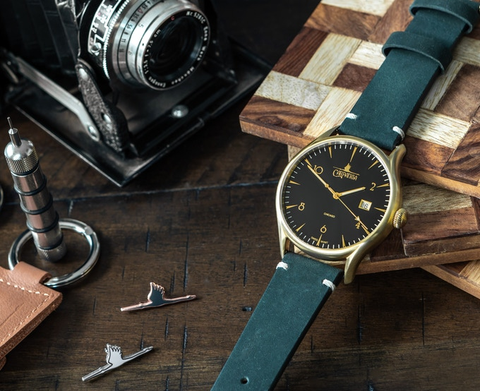 Ascent Brushed Gold on a racing green suede strap