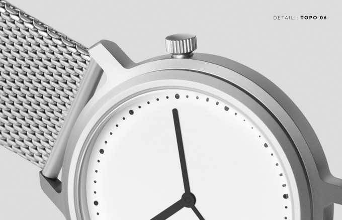 The raised top ring in Topo's watch casing alludes to the differentiated levels of a topography chart.