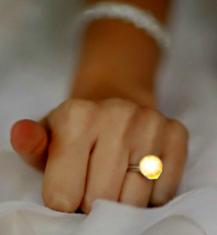 Flash Stone (Tm) Ring outshines any inert rock by a factor of 100 X
