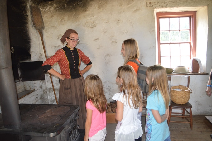 The Mann Girls at Old World Wisconsin, which depicts housing and the daily life of settlers in 19th-century Wisconsin