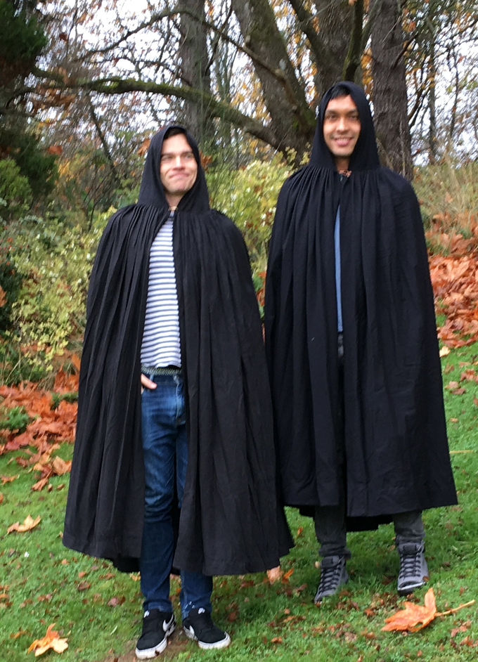 my Cowled Cloaks design: black silk noil (left)  black wool gabardine (right)